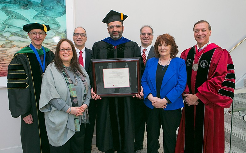 Dr. Ramin Parsey, center, at the ceremony installing him as Stony Brook University's first Della Pietra Chair of Biomedical Imaging. Also pictured are: Dr. Samuel L. Stanley Jr., President of Stony Brook University (far right); Dr. Kenneth Kaushansky, Senior Vice President for the Health Sciences and Dean, Stony Brook University School of Medicine (far left); along with members of the Della Pietra family, from left: Pamela Hurst-Della Pietra, Stephen Della Pietra, Vincent Della Pietra, and Barbara Amonson.