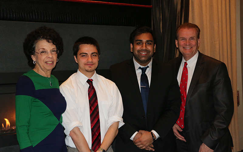 Gregory Poterwicz '16 (center left) and Ravi Patel '16 (center right) pose with Gloria Snyder '72, chair of the Past Presidents Council, and Bob Stafford '72, '82, president of the Stony Brook University Alumni Association, during a dinner reception on April 5 honoring the first three recipients of the University's Alumni Association Past Presidents Scholarship.