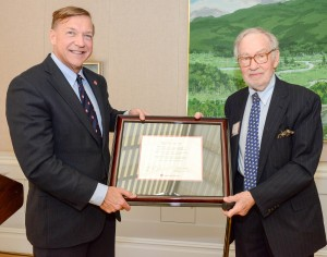 Stony Brook University President Samuel L. Stanley Jr. presents Eugene Thaw with a declaration honoring his generosity and support of the Pollock-Krasner House and Study Center and the establishment of the Eugene V. and Clare E. Thaw Endowed Chair in Modern American Art.