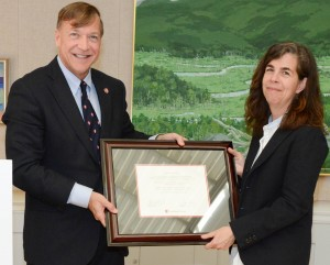 Stony Brook University President Samuel L. Stanley Jr. presents Katy Siegel with a declaration honoring her contributions in teaching, research and service to the field of modern American art during her appointment as the Eugene V. and Clare E. Thaw Endowed Chair in Modern American Art.