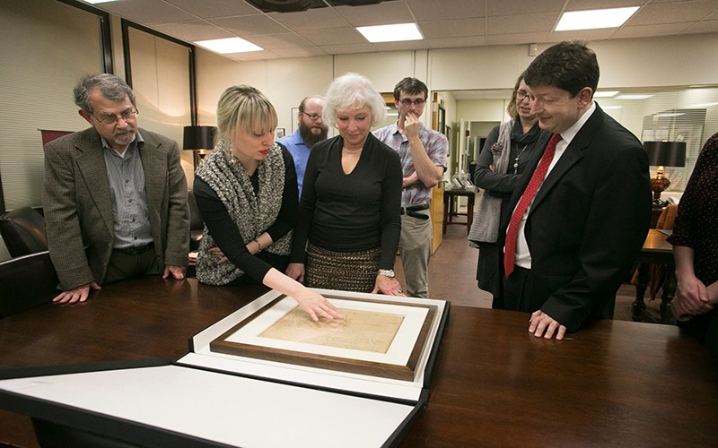 Commemorating the gift from the Robert David Lion Gardiner Foundation, establishing an endowed chair in the Department of History known as the Robert David Lion Gardiner Chair in American History, Executive Director Kathryn M. Curran enjoys a tour of the Melville Library Special Collections at Stony Brook University, where University Archivist, Kristen Nyitray, shared the history of one of the treasures from the collection -- an original letter from George Washington to Benjamin Tallmadge about the Culper Spy Ring. Pictured from left: Former History Chair, Gary Marker; Kristen Nyitray; Gardiner Fellow Lance Boos; Kathryn Curran; Gardiner Fellow Richard Tomczak; History Professor Jennifer Anderson; Dean of the College of Arts & Sciences, Sacha Kopp.
