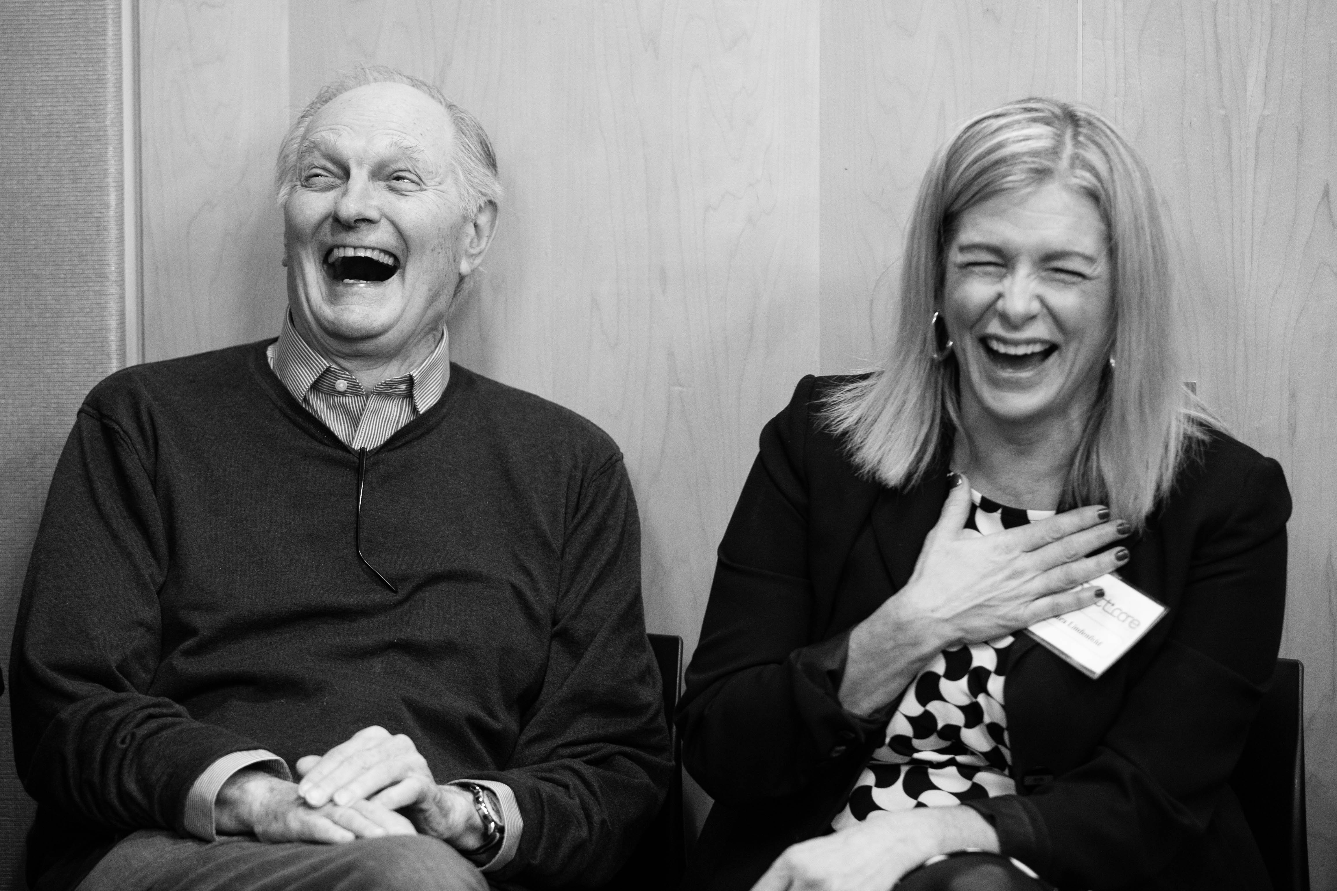 Laura Lindenfeld and Alan Alda laughing.