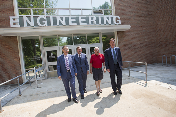 Pictured outside of the Engineering Building (est. 1963) are from left:  Fotis Sotiropoulos, Ph.D., Dean, School of Engineering and Applied Sciences; Samuel L. Stanley Jr., M.D., President; Kenneth LaValle, Chairman of the NYS Senate Higher Education Committee (1st Senate District); John Flanagan, NYS Senate Majority Leader (2nd Senate District).