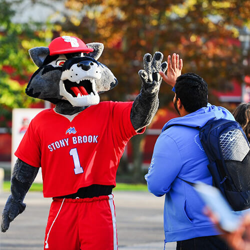Wolfie Hi-Fiving Student