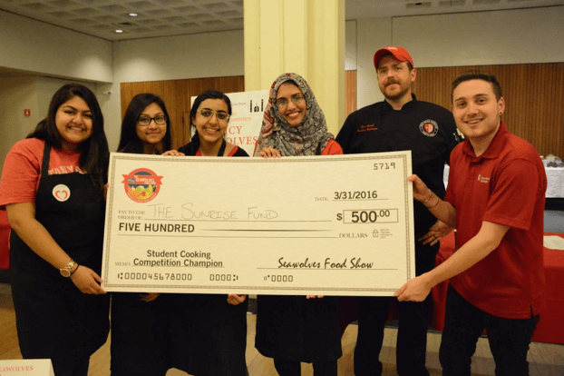 The Spicy Seawolves along with their Campus Dining chef, Ryan Carroll and Seawolves Food Show reporter Taylor Alessi showing off their grand prize of $500 that was donated to The Sunrise Fund.