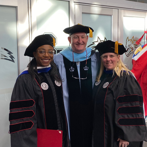 Thea Charles and Dawn Nachtigall at Ph.D. hooding ceremony with Dr. Keith Sheppard.