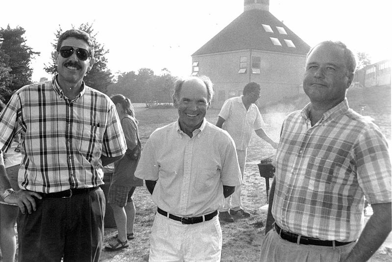 Lewis Greenstein, dean of the Friends World Program, faculty member Larry Liddle and an unidentified man at a barbecue celebrating the start of the 1995 academic year.