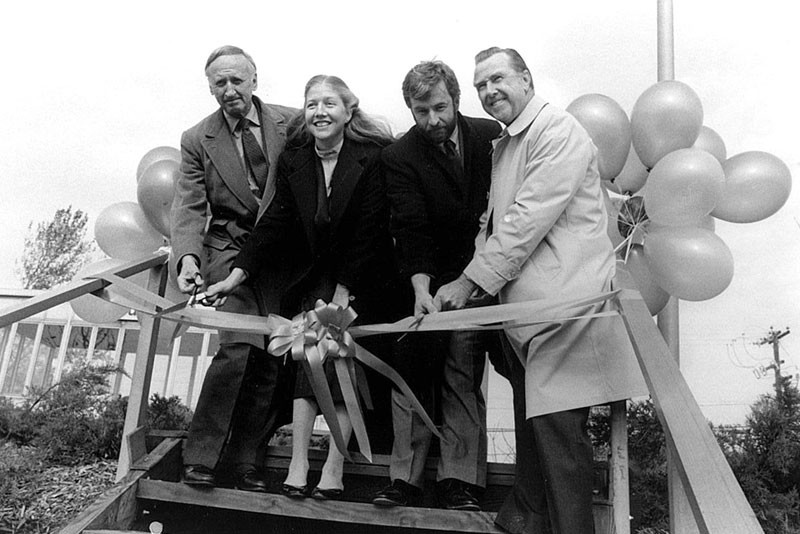 Southampton College chancellor Angier Biddle Duke, an unidentified woman, Tim Bishop and college president Edward C. Glanz in an undated ribbon cutting ceremony.