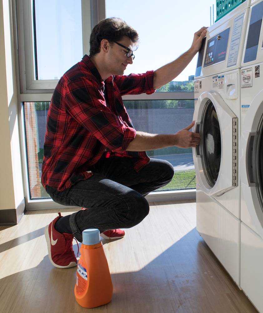 Student in laundry room