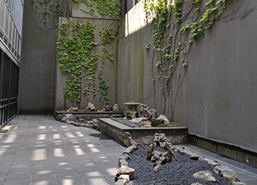 Zen Rock GardenLocated on the first floor, in between the meeting rooms 101 and 102 at the Charles B. Wang Center, this Japanese rock garden (枯山水 karesansui) was created by Gerard Senese and his wife Hiroko Uraga-Senese as a tribute to the appreciation of Japanese culture.