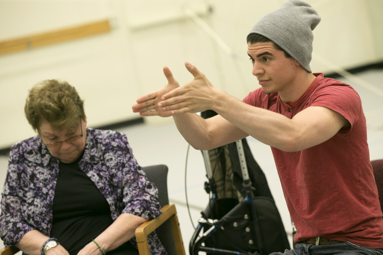 Neurobiology student Louis Susca dances with Parkinson's patients