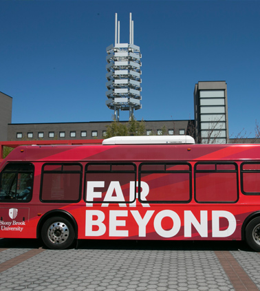 Stony Brook bus showing the branded slogan Far Beyond on its side