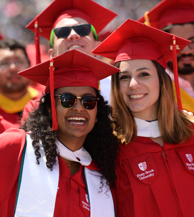 A group of happy Stony Brook graduates at Commencement ceremony