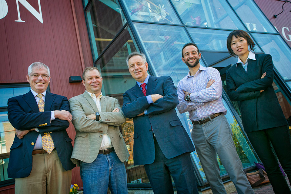 William Worek, Jon Longtin, Sotirios Mamalis and Ya Wang of the Department of Mechanical Engineering stand together for energy technology research with Provost Dennis Assanis (center)