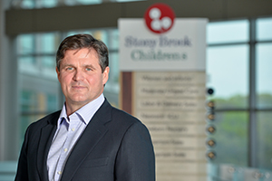 Stony Brook, NY; Stony Brook University Medical Center: Cofounder of the Tritec Real Estate Co. Jim Coughlan stands in the lobby of Stony Brook Children's Hospital. (5/9/16)