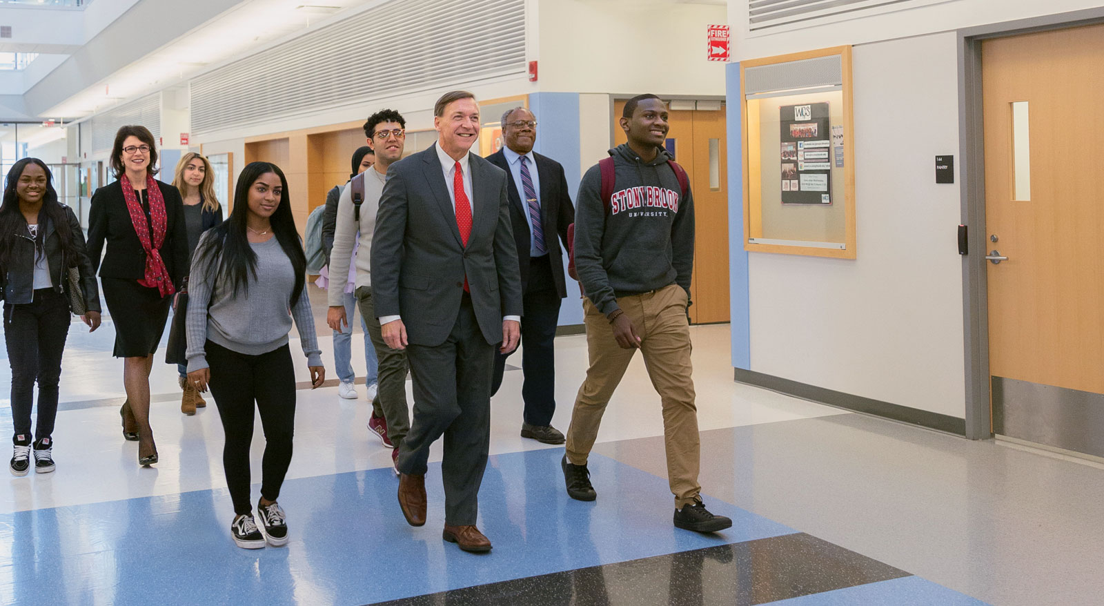 At Stony Brook University, a committed campus community, led by President Samuel L. Stanley Jr. (front) and faculty and staff like Provost's Scholar for Diversity and Innovation David Ferguson and Career Center Director Marianna Savoca (also pictured), is helping economically disadvantaged students move up the socioeconomic ladder.