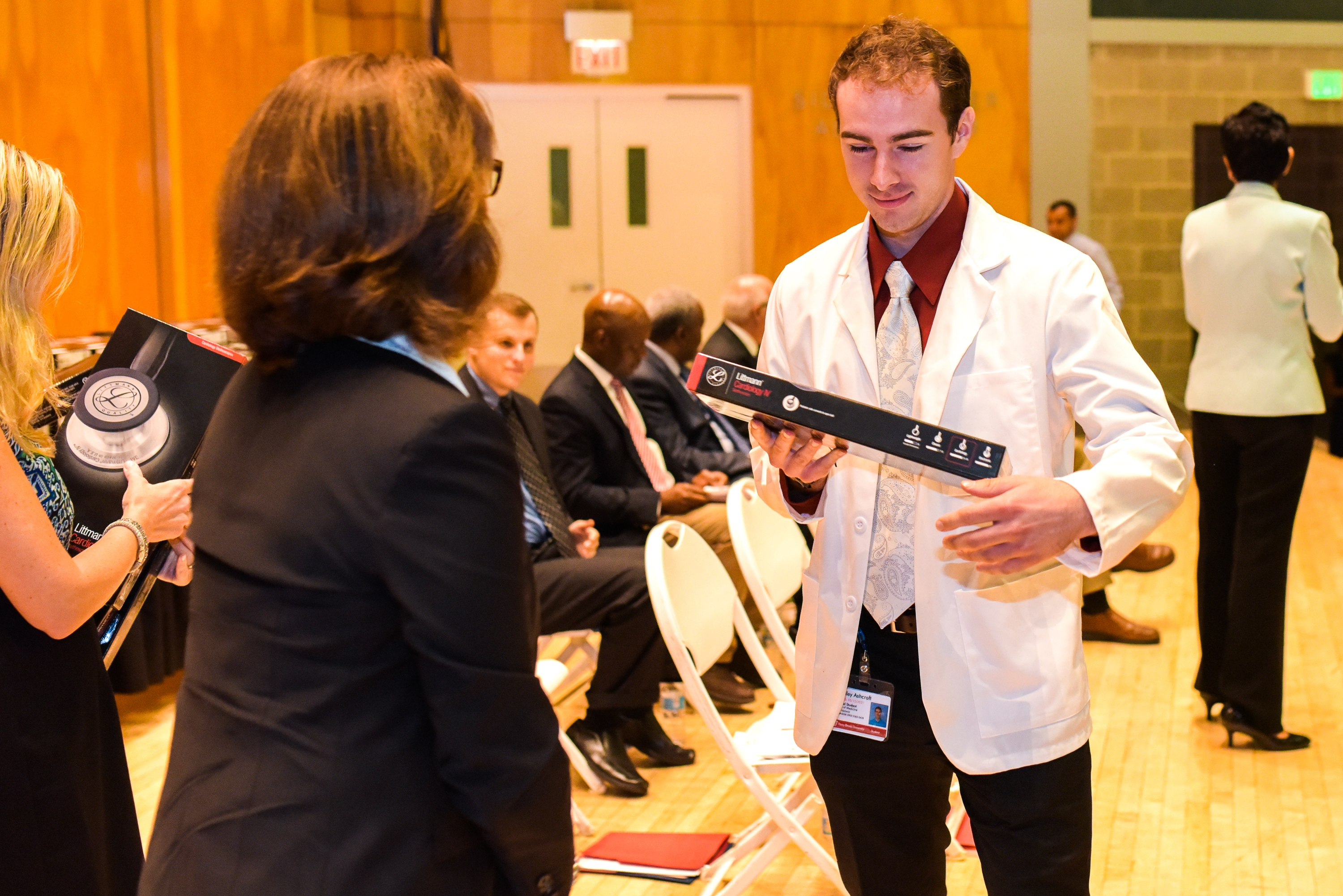 Receiving stethoscopes at their White Coat Ceremony helps students like Bradley Ashcroft '21 feel the support of the School of Medicine alumni who have come before them.