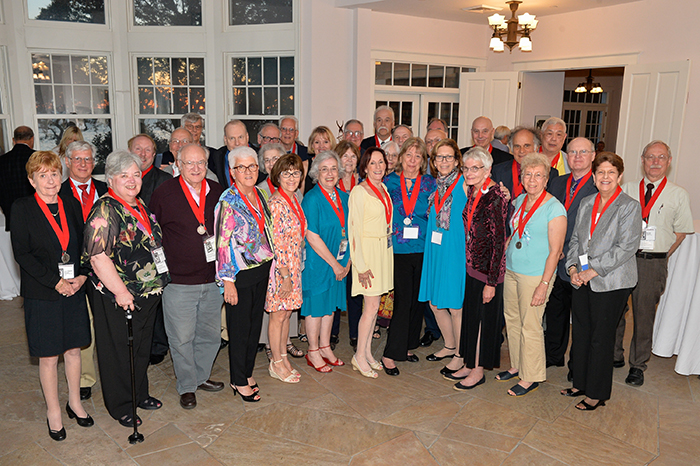 Members of the Class of 1967 — the newest inductees to the Brook Heritage Society — pose for a photo at the Sunwood estate.