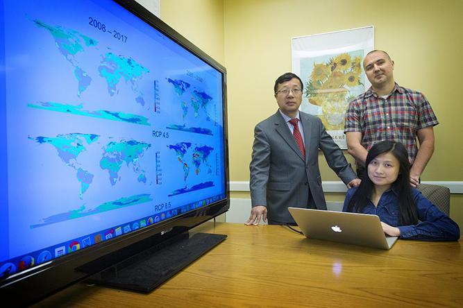 Minghua Zhang (Dean of SOMAS), Tingyin Xiao (PhD student) and Oleg Smirnov (Political Science, CAS)