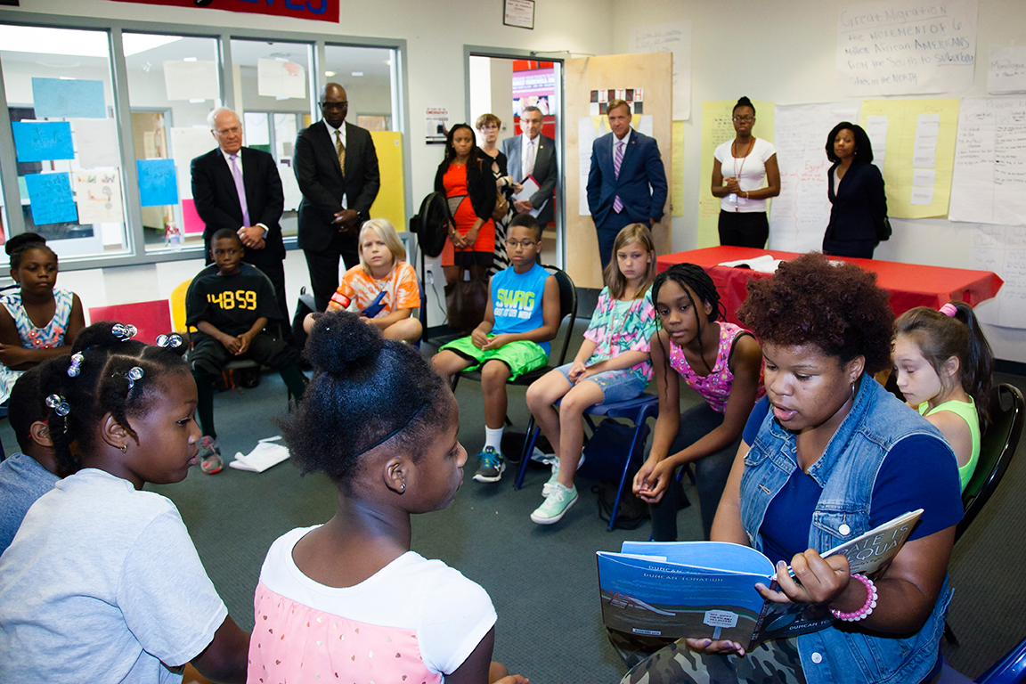 Stony Brook, NY; Tabler Center for Arts, Culture and Humanities, Stony Brook University: Stony Brook University President, Samuel L. Stanley Jr., with his guests, MD, Dr. Thomas Howard, Stephen J. Dannhauser, and Sheena Wright, visit the classrooms of scholars, attending the Children's Defense Fund Freedom School, on August 6, 2015. Photo by Heather Walsh