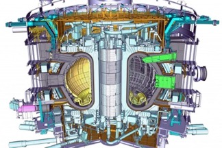 A model of the ITER tokamak, an experimental machine designed to harness the energy of fusion. A powerful magnetic field is used to confine the plasma, which is held in a doughnut-shaped vessel. (Credit: ITER Organization)