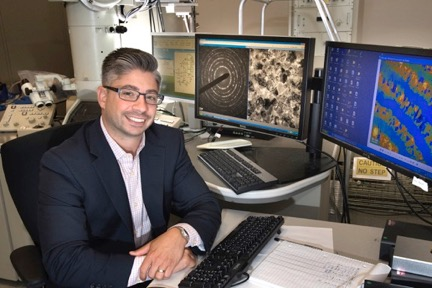 Materials scientist Jason Trelewicz in an electron microscopy laboratory at Brookhaven National Lab's Center for Functional Nanomaterials, where he characterizes nanoscale structures in metals mixed with other elements.