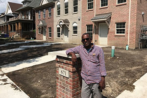 Bateau in front of the 57-unit affordable house project he is completing in Midtown Detriot.