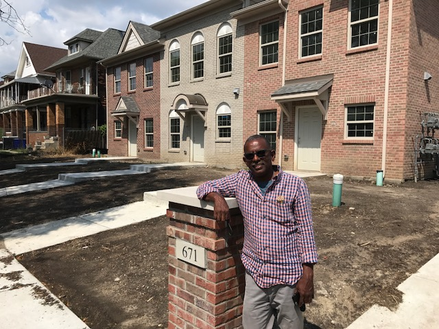 Julio Bateau in front of the 57-unit affordable house project he is completing in Midtown Detriot.