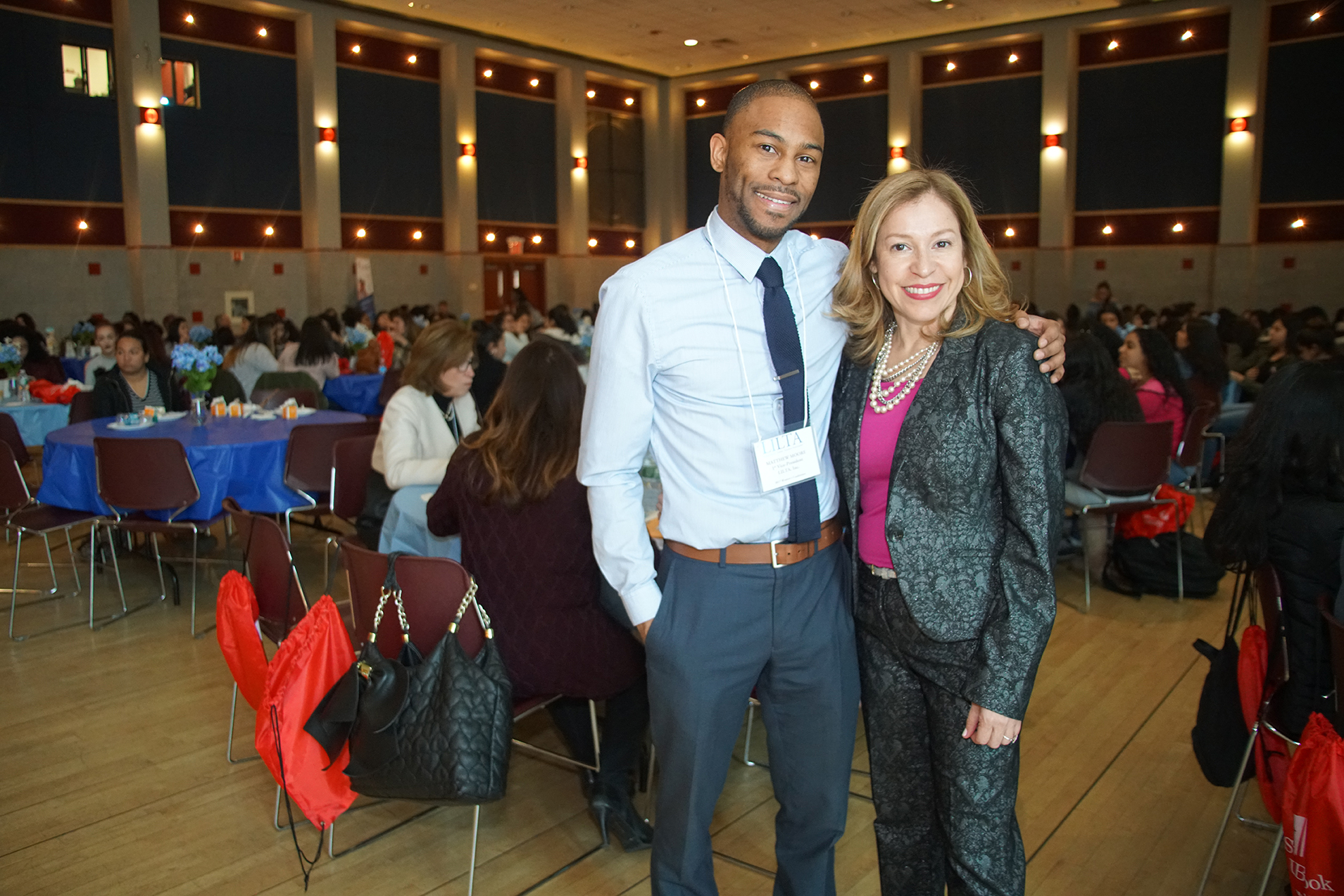 Conference organizers Dafny Irizary, President, Long Island Latino Teachers Association, and Matthew Moore, SBU Presidential Fellow.