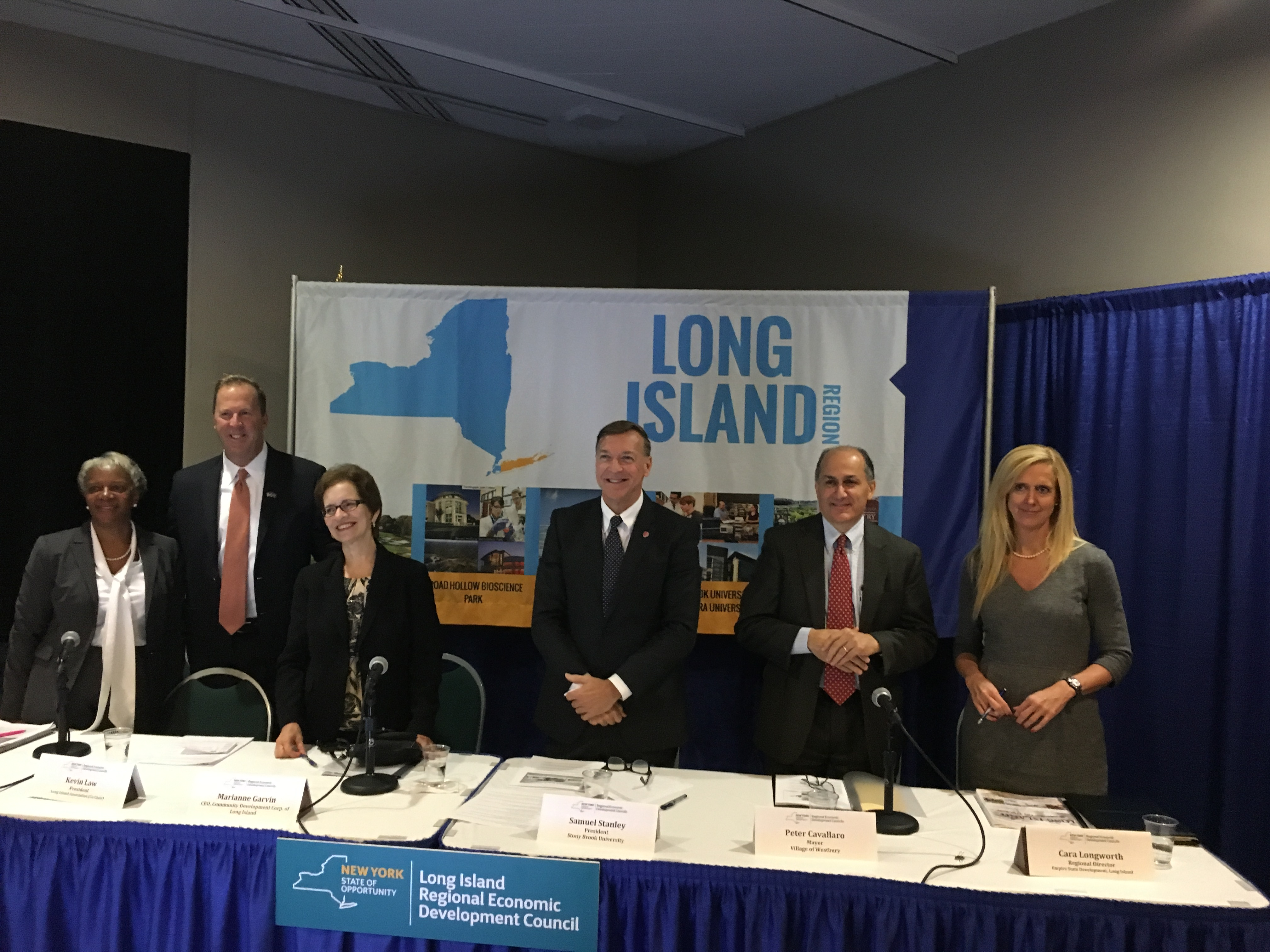 Left to right: LIREDC representatives Patricia Edwards, Kevin Law, Marianne Garvin, and President Stanley, with Peter Cavallaro and Cara Longworth.
