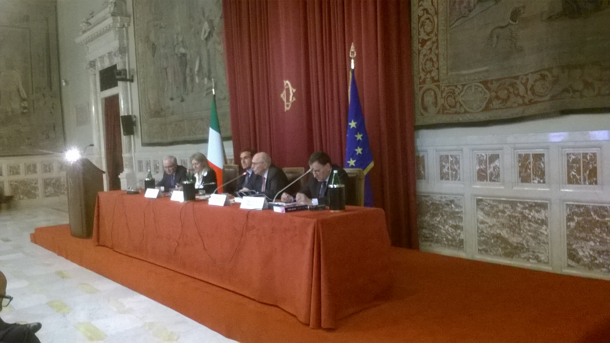 Professor Mario Mignone and Panel addressing the Chamber of Deputies in Queens Hall, Italian Parliament, Rome, Italy. Left to right: Franco Vitelli, Giulia Dell'Aquila, Hon. Stefano Dambruoso, Mario Mignone, Sebastiano Martelli