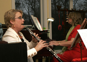 "Dr. Matos-Puente Playing the Oboe at ""Opera Night."""