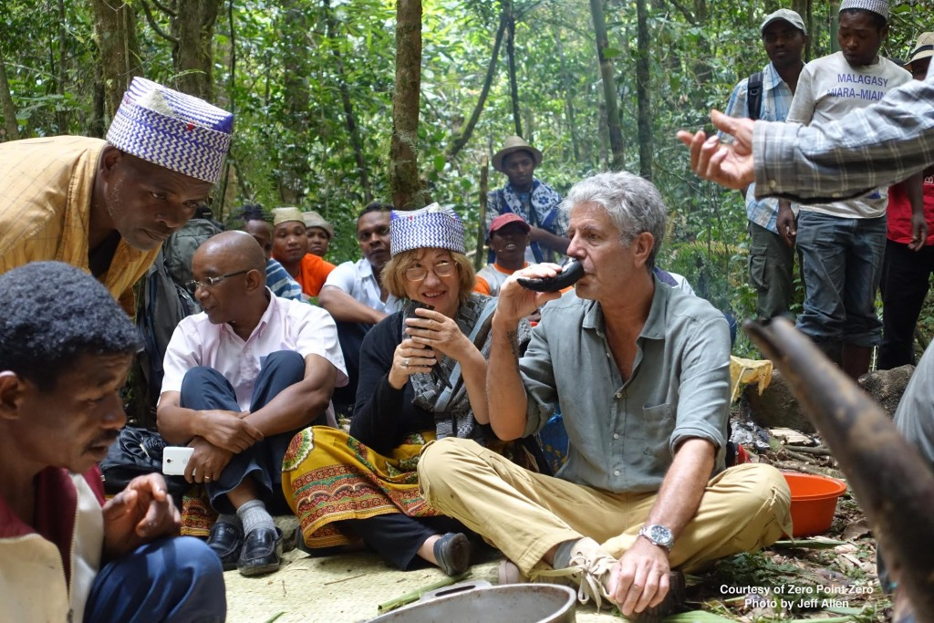 Pat Wright and Anthony Bourdain participate in a Zemu sacrifice in Madagascar.
