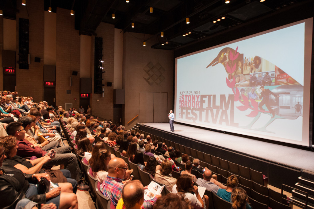 Inkles welcomes the audience to the 2014 Festival in front of the Staller Center's 40-foot-wide screen