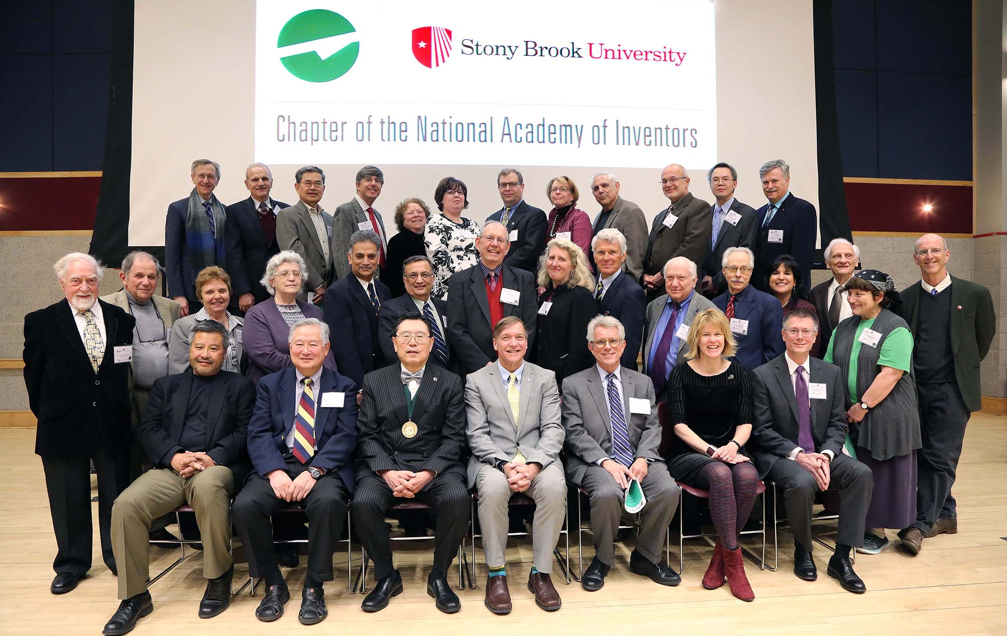 The 30 inaugural members with SBU President Samuel L. Stanley Jr. (seated, center), SBU-NAI President Iwao Ojima (next to Dr. Stanley, left), Vice President for Research David Conover (next to Dr. Stanley, right), and Director of Technology Licensing/Industry Relations Peter Donnelly (seated, far right)