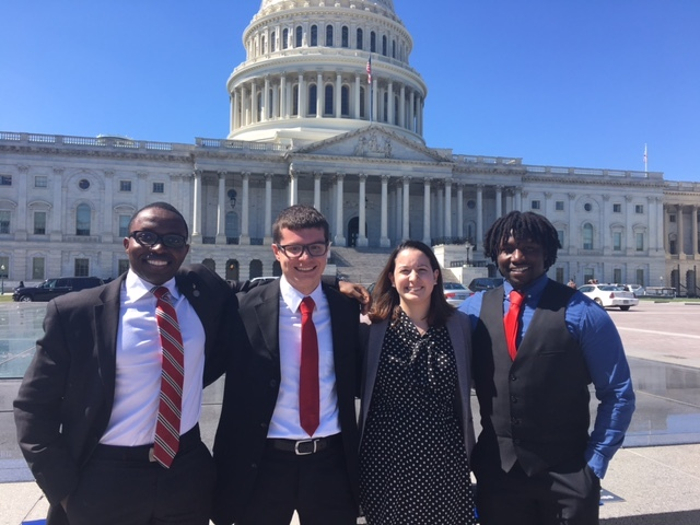 Seawolves in front of the Capitol (left to right) Jean-Doris Muhuza, Patrick Smith, Kayla Gogarty and Lyl Tomlinson