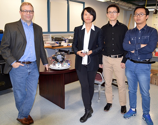 Ya Wang (center) and Jon Longtin (left) are PI and Co-PI on this project.
