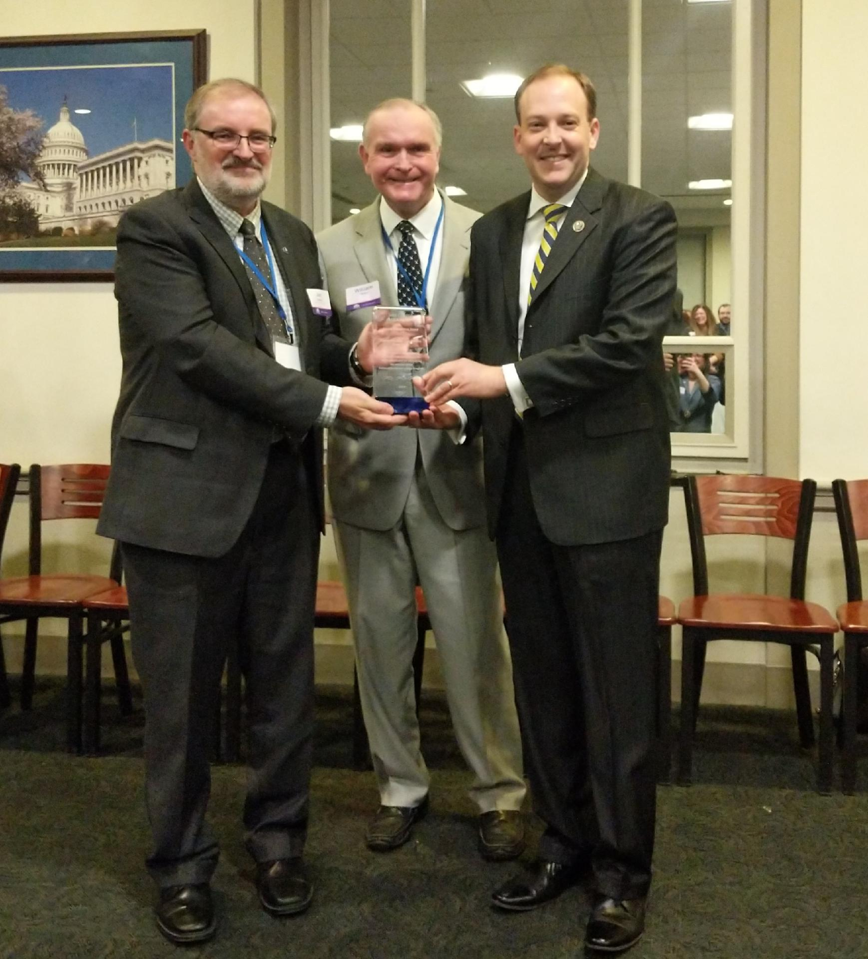 Congressman Lee Zeldin (right) receives the award from NYSG Director Bill Wise (center) and Wisconsin Sea Grant Director Jim Hurley, who is also President of Sea Grant Association.