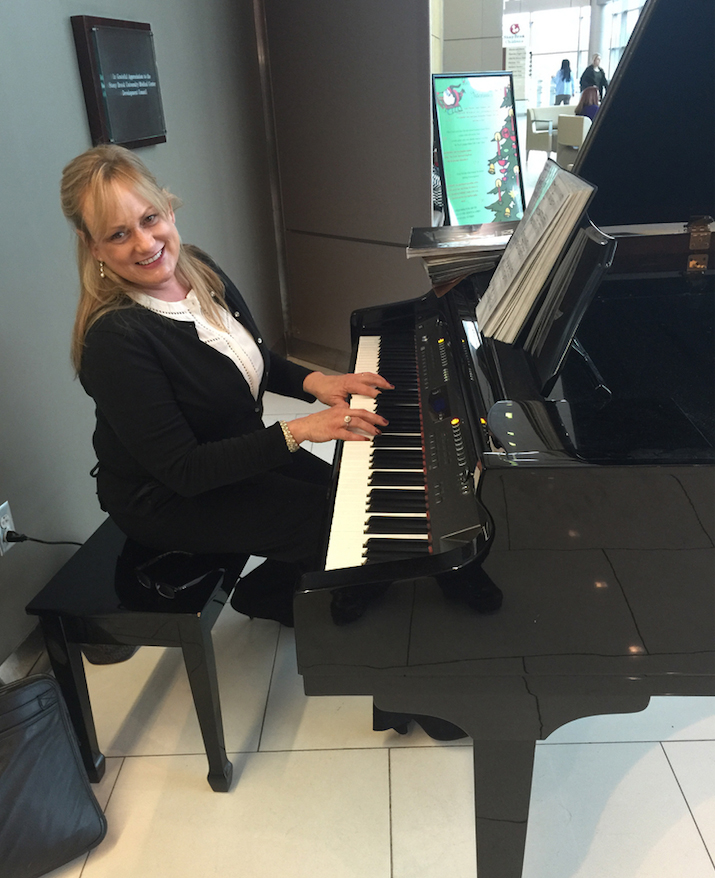 Allison Van Cott playing the piano at the hospital.