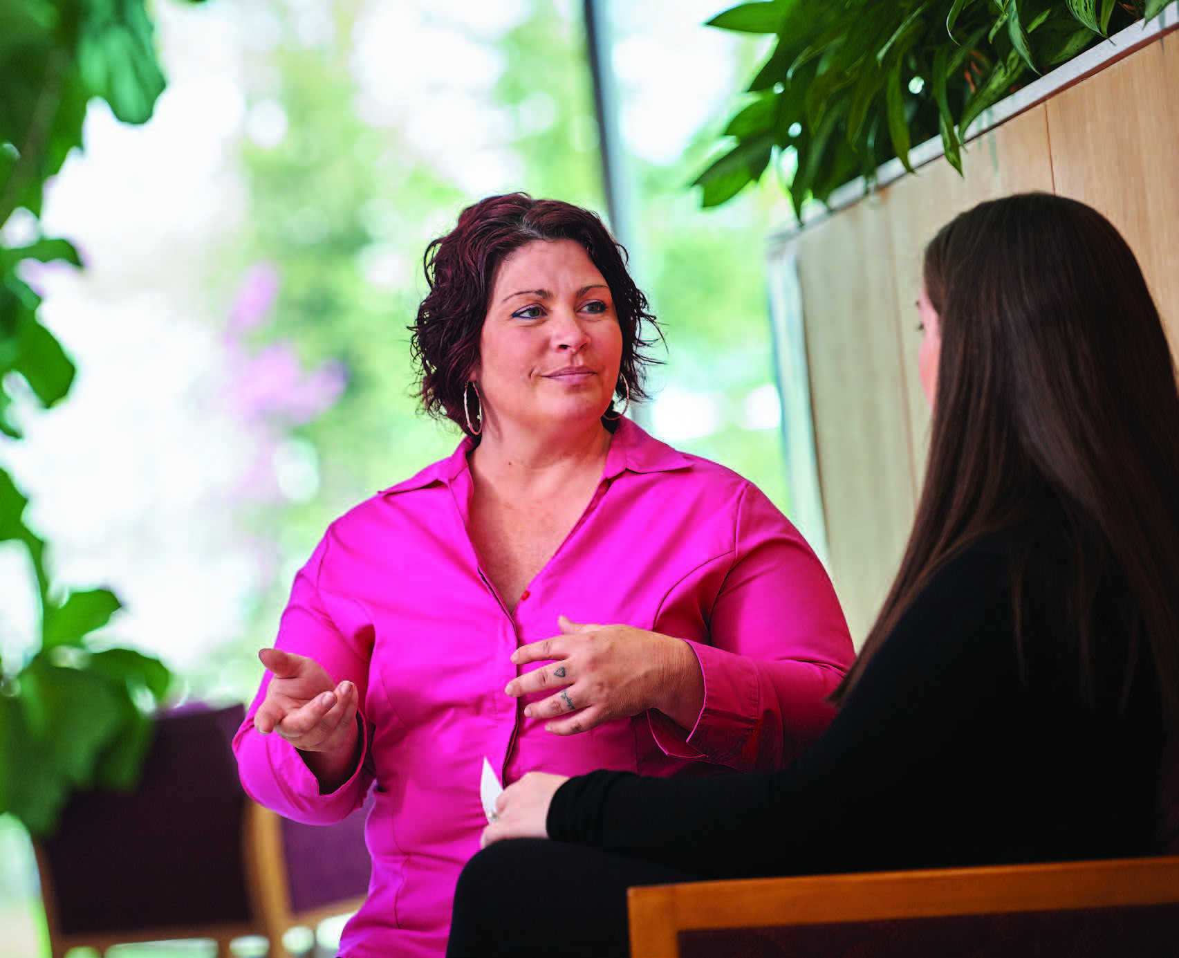 As part of her cancer team care, patient Lafler (left) meets with social worker Alicia Italiano.