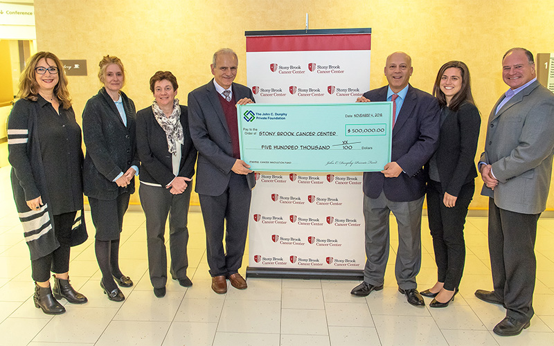 Members of the John C. Dunphy Foundation presented a check at the Stony Brook Medicine Cancer Center for $500,000.00