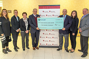 Members of the John C. Dumphy Foundation presented a check at the Stony Brook Medicine Cancer Center for $500,000.00