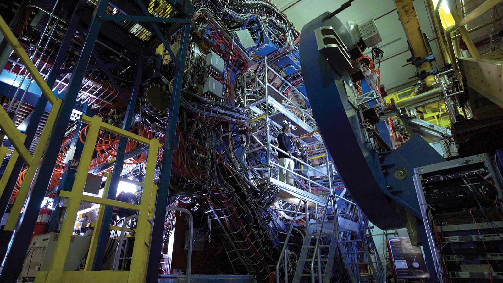 Roy Lacey within the STAR detector, which specializes in tracking the thousands of particles produced by each ion collision at RHIC.
