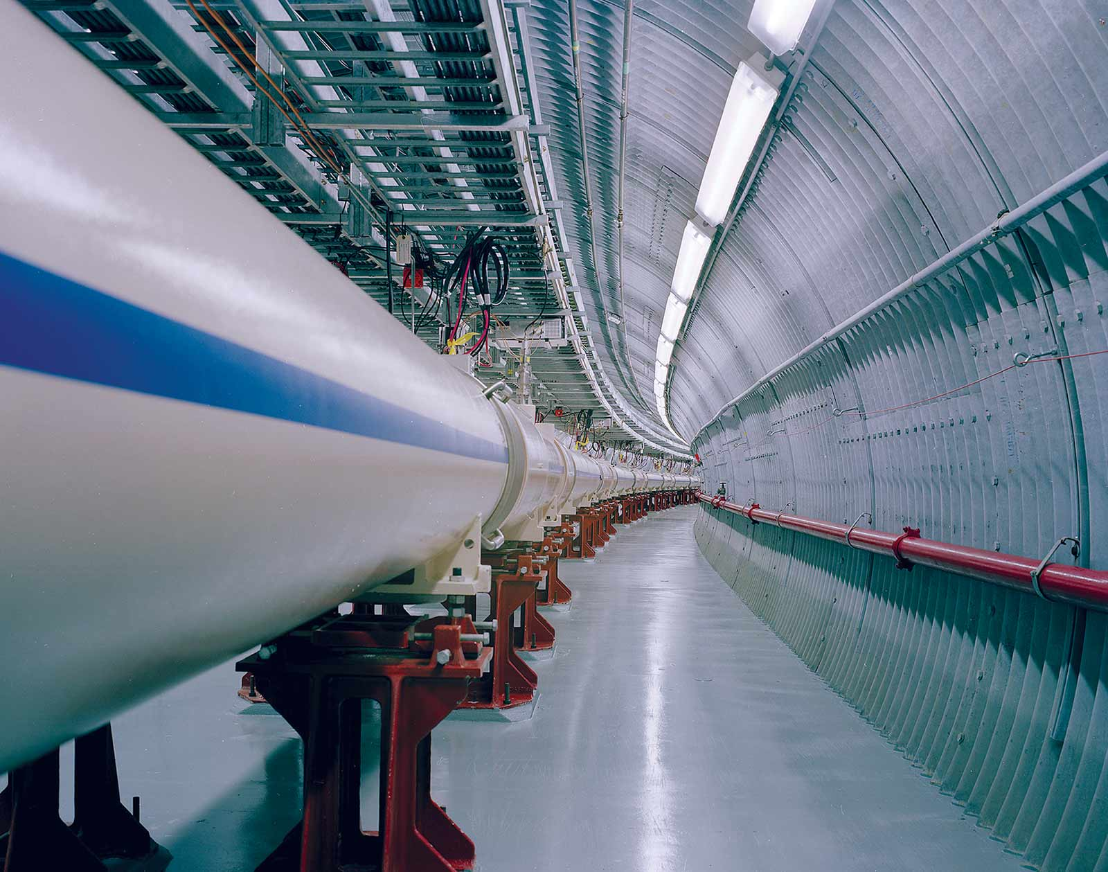 Made of intersecting rings of superconductor magnets, the RHIC is enclosed in a tunnel 2.4 miles in circumference.