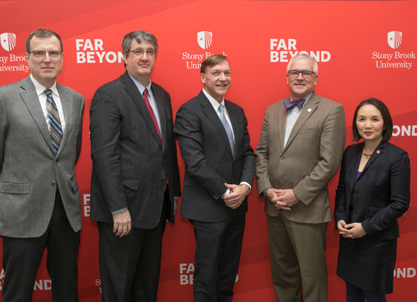 Marking implementation of Stony Brook University's 100 Gbps Internet2 connection are, left to right, Robert Harrison; Chris Sedore; President Samuel L. Stanley, Jr.; George Loftus; CIO Melissa Woo.