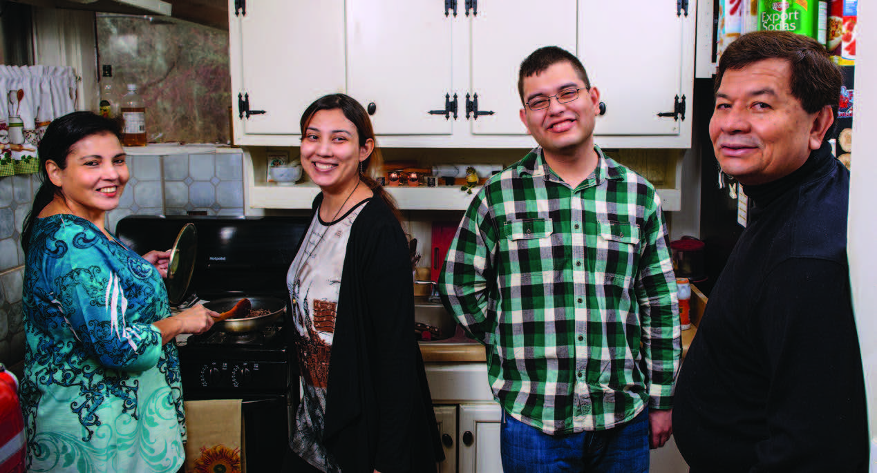 Edgar Samudio '17 (center right) chose to attend college close to home to be near his parents (pictured). His sister Amy '17 (center left) also graduated in May.