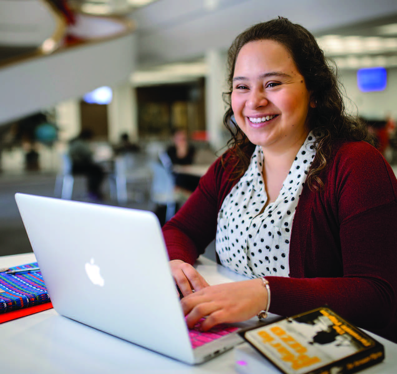Biology major Karla Reyes Ortiz '17 studies in the Melville Library between classes and her internship with the student-run Health Outreach and Medical Education clinic.