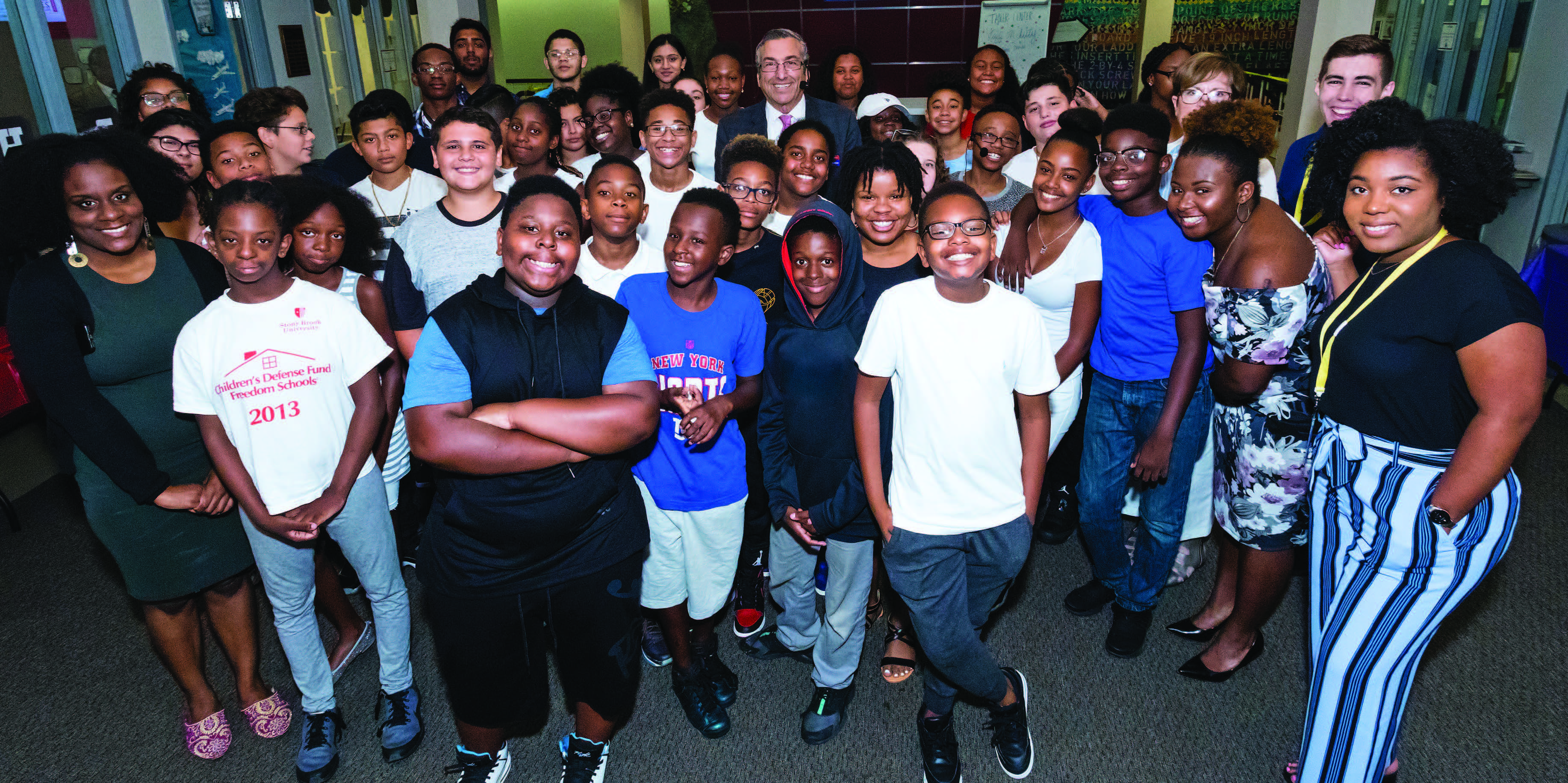 Charles Robbins (center), vice provost and director of SBU's Freedom School, is flanked by the program's 2017 graduates.
