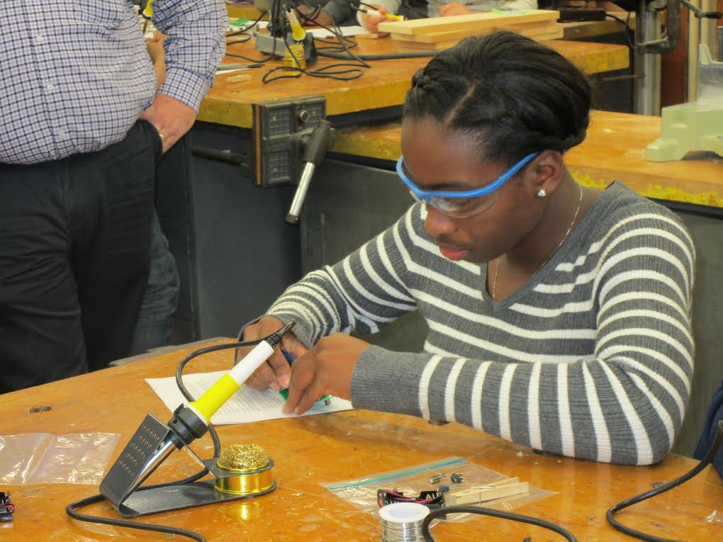 Alexandrea Harriott soldering to begin her persistence of vision project.
