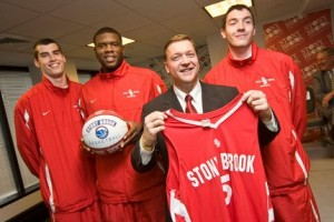 President Stanley and basketball team members
